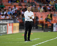 Toronto FC head coach Ryan Nelsen watches his team during a game at RFK Stadium in Washington, DC.  D.C. United tied Toronto FC, 1-1.