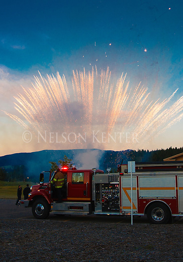 fireworks at the start of the missoula marathon in missoula, montana with a firetruck