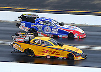 Jul 12, 2015; Joliet, IL, USA; NHRA funny car driver Del Worsham (near) races alongside Robert Hight during the Route 66 Nationals at Route 66 Raceway. The round win is the 500th of Worsham's career. Mandatory Credit: Mark J. Rebilas-USA TODAY Sports
