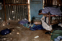 The abandoned body of Ibrahim Fullah, 41, lies in the shack where he lived and died by himself on Bangura Road, in the Kissy Town community. It is suspected that he died of ebola and an IFRC Safe and Dignified Burial Team will collect his body.