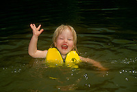 2-3 year old girl in water alone, a good swimmer