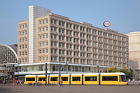The Berolinahaus, built 1929-32 by Peter Behrens, used for retail and offices, on the Alexanderplatz, with an U-Bahn in the foreground, Berlin, Germany. This classical modernist building has been protected since 1975 as an example of the Neuen Sachlichkeit or New Objectivity style. Picture by Manuel Cohen