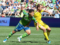 Seattle Sounders FC forward Fredy Montero and Columbus Crew defender Rich Balchan  battle for the ball during play at CenturyLink Field in Seattle Saturday Aug. 27, 2011. The Sounders FC won the game 6-2.
