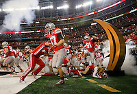 Ohio State players and cheerleaders stumble as they enter the field prior to the College Football Playoff National Championship against Oregon at AT&T Stadium in Arlington, Texas on Jan. 12, 2015. (Adam Cairns / The Columbus Dispatch)