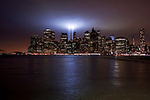 New  York, New York.September 11, 2011..To honor the 3,000 lives lost on September 11, 2001, two bright lights are pointed skyward within the New York City skyline, where the World Trade Towers once stood...As on each of the ten anniversaries since the Sept. 11 attack, New York has illuminated the sky with its Tribute Lights. A total of 88 spotlights sit where the twin towers once did, thanks to the The Municipal Art Society of New York.