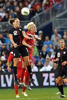 USWNT midfielder Lauren Cheney (12) wins the header against Sophie Schmidt.