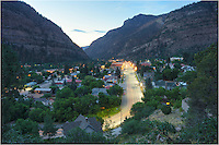 "This is the view you have as you wind down into ""The Little Switzerland"" of Colorado - Ouray. This Colorado image was taken in the evening as I returned from Yankee Boy Basin. The landscape you see from this highway is breathtaking, and Ouray sits in between high rising mountains in three directions. The only exit not requiring some uphill driving is north to Ridgway. It is a great town to stay in and explore, fun for those who wish to shop or for outdoor enthusiasts."