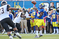 Newark, DE - October 29, 2016: Towson Tigers linebacker Diondre Wallace (56) applies pressure to Delaware Fightin Blue Hens quarterback Joe Walker (3) during game between Towson and Delware at  Delaware Stadium in Newark, DE.  (Photo by Elliott Brown/Media Images International)