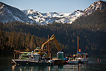 The barge work station in Emerald Bay where divers are placing mats on the lake floor to control Asian clams, an invasive species to Lake Tahoe at Camp Richardson, Calif., October 30, 2012.