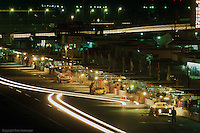 View of the pit lane at night during the 1987 24 Hours of Daytona IMSA race in Daytona Beach, Florida.