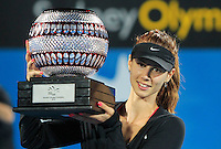 Tsvetana Pironkova of Bulgaria poses with her trophy after defeating Angelique Kerber of Germany during their final match at the Sydney International tennis tournament, Jan. 10, 2014.  Daniel Munoz/Viewpress IMAGE RESTRICTED TO EDITORIAL USE ONLY