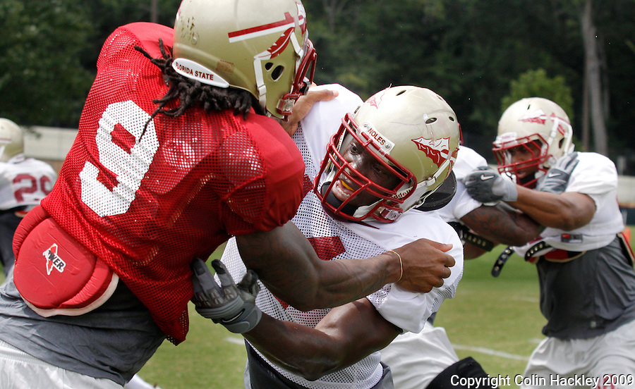 TALLAHASSEE, FL. 8/14/09-FSU-HARRIS 0814 CH01-Florida State wide receiver Richard Goodman, left, and linebacker Maurice Harris grapple during practice Friday in Tallahassee...COLIN HACKLEY PHOTO