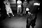 Wroclaw 19.08.2009 Poland<br /> Cops identify aggressive youth in the Bermuda Triangle.<br /> The worst and the most dangerous district in Wroclaw ( Poland ), called by people &quot;The Bermuda Triangle&quot;.<br /> Photo by Adam Lach / Napo Images<br /> <br /> Policjanci spisuja agresywna mlodziez w Trojkacie Bermudzkim.<br /> Najbardziej nabezpieczna dzielnica we Wroclawiu zwana przez ludzi Trojkatem Bermudzkim.<br /> Fot Adam Lach / Napo Images