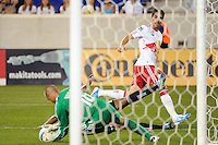 Juan Pablo Angel (9) of the New York Red Bulls has his shot saved by San Jose Earthquakes goalkeeper Jon Busch (18). The New York Red Bulls defeated the San Jose Earthquakes 2-0 during a Major League Soccer (MLS) match at Red Bull Arena in Harrison, NJ, on August 28, 2010.