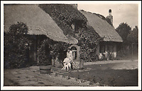 BNPS.co.uk (01202 558833)<br /> Pic: IAA/BNPS<br /> <br /> Enid Blyton with Bobs on a wishing well outside her picturesque thatched cottage in Bourne End, Bucks.<br /> <br /> Enchanting photographs of children's author Enid Blyton with the pet dog that inspired many of her early works have come to light.<br /> <br /> The black and white photos depict Bobs, Blyton's fox terrier who became a celebrity in his own right after she started writing letters from him in the magazine Teacher's World in 1933.<br /> <br /> The signed letter and the picture postcards were sold by International Autograph Auctions of Nottingham for &pound;200.
