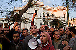 A group of more than 1000 Egyptian protesters chants anti-government slogans outside the gates of the Parliament building February 08, 2011 in Cairo, Egypt. The numbers of protesters in and around Tahrir swelled again today after a few days where it seemed momentum had been lost and the crowds were thinning. .Credit: Scott Nelson