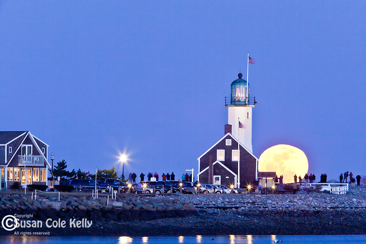 The full worm moon rises by Scituate Light in Scituate, MA, USA
