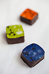 Winner of the Prix de l'Artisanat de Genève 2006, Philippe Pascoët mixes different varieties of chocolate, fruit purees, and herbs to produce original creations such as passion fruit, black currant and saffron-flavoured chocolates. Located in the Carouge neighborhood in Geneva, Switzerland, Europe