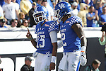 Quarterback Stephen Johnson #15 of the Kentucky Wildcats celebrates with wide receiver Dorian Baker #2 after scoring a touchdown during the second half of the TaxSlayer Bowl against the Georgia Tech Yellow Jackets at EverBank Field on Saturday, December 31, 2016 in Jacksonville, Florida. Photo by Michael Reaves | Staff.