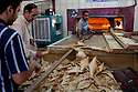 Iraqi bakers pump out dozens of loaves of fresh bread prior to the Ramadan iftar meal inside the thriving central market place in the Amil neighborhood in Southwest Baghdad August 23, 2010. Through an increase in Iraqi security force checkpoints and gated communities, Iraqis have enjoyed a vast improvement in terms of security over the past two years in areas like Amil, which previously had been sectarian battlefields with Iraqis forced to remain inside their homes for protection.   .