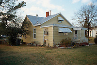 1990 December..Conservation.Ballentine Place..BEFORE REHAB.2648 MCKANN AVENUE.EXTERIOR BACKYARD LEFT SIDE.OWNER: MARY HUNTER...NEG#.NRHA#..