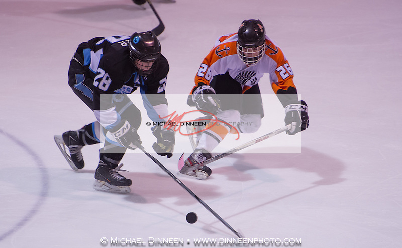 Chugiak's John Hammer, left and West's Ole Fair battle for the puck January 14, 2016.  Photo for the Star by Michael Dinneen