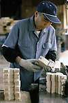 After cutting the horses from a wooden pattern a workman checks the cuts at the Hachinohe Toy Wooden Horse Factory in Hachinohe, Japan. The Hachinohe horse or Yawata Uma is made in a small factory, where, for eight hours a day, six days a week, 11 workers cuts, chisel, sand, paint and shellac wooded horses of all sizes ranging from just over an inch to nearly a foot high. (Jim Bryant Photo).....