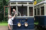 Foto: VidiPhoto<br /> <br /> ARNHEM - De 75-jarige instructeur Rob van Oostenrijk (l) van het Nederlands Openluchtmuseum in Arnhem legt trambestuurder Ton Sch&uuml;ler (76) woensdag uit hoe de 105 jaar oude tram A327 bestuurd moet worden. De historische tram vervoerde tussen 1911 en 1948 passagiers in Haarlem en deed vervolgens dienst in Leiden tot 1960. Eigenaar van het hoogbejaarde transportmiddel is de Tramwegstichting en is een week lang uitgeleend aan het Openluchtmuseum. Dit weekend staan historische trams, stads- en streekbussen uit het hele land er centraal tijdens het evenement &quot;Volgende halte: Openluchtmuseum!&quot; Tot die tijd krijgen de trambestuurders instructie in de bediening van schakelkast en remmen, dat bij ieder tram toch weer anders is. Vorig jaar werd het spektakel voor het eerst georganiseerd. De belangstelling van het publiek was zo groot dat het museum besloot dit jaar opnieuw de oude voertuigen naar Arnhem te laten komen. Het publiek kan bij enkele bussen en de trams instappen voor een ritje. Kinderen krijgen tramles van instructeurs en mogen een echt tramuniform aantrekken. Het trambedrijf van het Openluchtmuseum bestaat dit jaar precies 20 jaar.