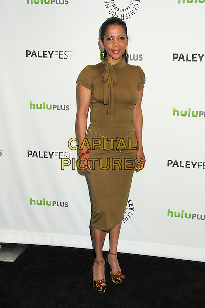 "Penny Johnson Jerald.PaleyFest 2012 Presents ""Castle"" held at The Saban Theatre, Beverly Hills, California, USA, 9th March 2012..full length green dress  olive khaki  gold chain belts .CAP/ADM/BP.©Byron Purvis/AdMedia/Capital Pictures."