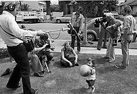 "Actress Jodie Foster, age 14, (seated on ground) being filmed in ""Americans,"" a documentary by British producer/director Desmond Wilcox. Los Angeles, June, 1977. Photo by John G. Zimmerman"