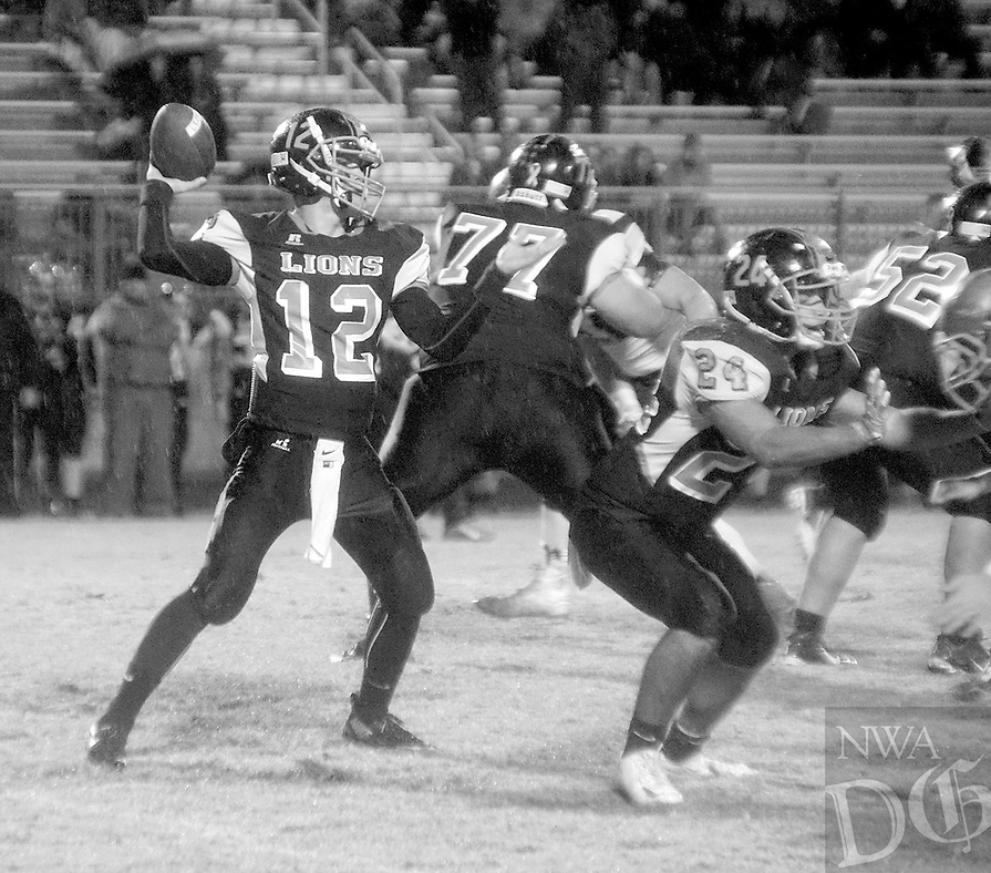 Photo by Randy Moll<br /> Behind the blocking of Jordan Burnett and Nelson Payne, Bryce Moorman passes to a Gravette receiver downfield during play between Gravette and Shiloh Christian on Friday, Oct. 30, 2015, in Gravette.