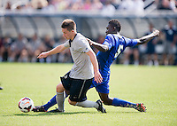 Alex Muyl (9) of Georgetown fights for the ball with Bolu Akinyode (5) of Seton Hall during the game at Shaw Field in Washington, DC.  Georgetown defeated Seton Hall, 8-0.