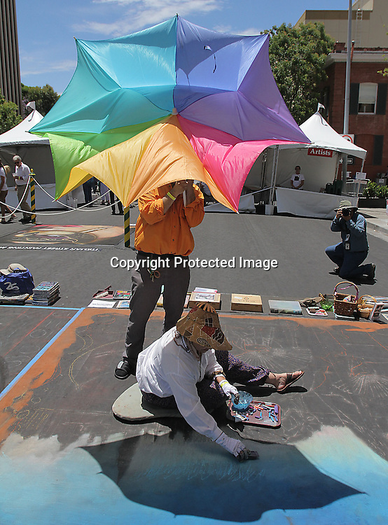 Held annually in downtown San Rafael, California, our signature event showcases approximately 100 master street painters who turn the streets into an amazing gallery. View the world through the eyes of our Madonnari and enjoy this captivating ephemeral experience.