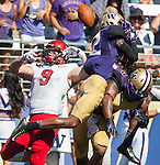 Eastern Washington Eagles' tight end Zach Wimberly (9)  pass is  broken up by Washington Huskies'  Jermaine Kelly (6) and Budda Baker (32) at Husky Stadium September 6, 2014 in Seattle. Huskies out lasted the Eagles in a high powered shootout 59-52 in the third highest scoring game in Husky history.  Wimberly caught 2 passes for 28 yards and scored 1 touchdown. ©2014. Jim Bryant  Photo. All Rights Reserved