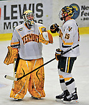 23 January 2009: University of Vermont Catamount goaltender Rob Madore, a Freshman from Venetia, PA, is congratulated by defenseman Kevan Miller, a Sophomore from Los Angeles, CA, at the final buzzer against the University of Massachusetts Minutemen after the first game of a weekend series at Gutterson Fieldhouse in Burlington, Vermont. The Catamounts defeated the visiting Minutemen 2-1. Mandatory Photo Credit: Ed Wolfstein Photo