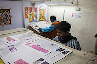 Workers print the current issue of Khabar Lahariya weekly newspaper, after receiving the files from the Khabar Lahariya Chitrakoot office, in Allahabad, Uttar Pradesh, India on 06 December 2012. Photo by Suzanne Lee / Marie Claire France
