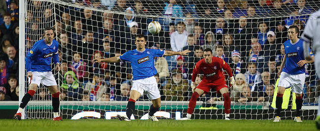 David Weir, Lee McCulloch and Danny Wilson protect Allan McGregor in a makeshift Rangers defence lacking the absent Madjid Bougherra