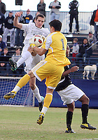 Steve Neumann #18 of Georgetown University loses the ball to Jhojan Obando #1 of Providence University during a Big East quarter-final  match at North Kehoe Field, Georgetown University on November 6 2010 in Washington D.C. Providence won 2-1.
