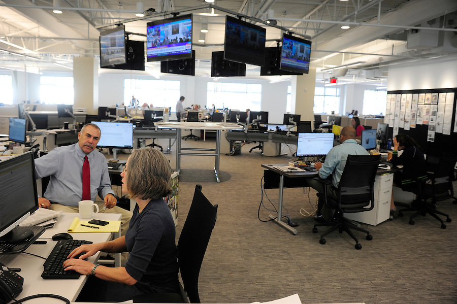 Post-Gazette's new newsroom at 358 North Shore Dr. in Pittsburgh. Here editors Matt Smith and Lillian Thomas work on an afternoon task. Tim Martin AME News for the Pittsburgh Post-Gazette retires September, 2015