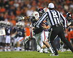 Auburn quarterback Clint Moseley (15) is tackled by Ole Miss' Gerald Rivers (90) at Jordan-Hare Stadium in Auburn, Ala. on Saturday, October 29, 2011. .