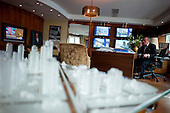 Istanbul, Turkey<br /> March 11, 2011<br /> <br /> In his office Ali Ibrahim Agaoglu, age 56, is the chairman of 25-year-old Agaoglu Group, a builder of hotels, resorts, and ski lodges in Turkey; also one of Turkey's biggest housing providers. Even during 2009 downturn, was moving ahead with plans to eventually build 24,000 houses in four projects in Istanbul. Net worth according to Forbes Magazine on March 10, 2011 is $2 billion US; owns 90 million square feet of developable land on western coast of Turkey and continues to buy up parcels opportunistically. His Istanbul residential estate project called My City Bahcelievler sold 300 units in 3 days in mid-February. Announced plans to invest $2 billion in tourism projects including hotels and malls. Started working right after high school. Divorcee's so-called playboy antics with bikini-clad younger women closely tracked by local media. Hops around in his $4.5 million Bell 430 helicopter.  Passionate about luxury cars, has a Lamborghini, two Bentleys and a Ferrari California.