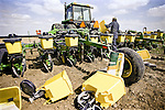 A farmer prepares his drill for planting corn in springtime in Colorado.