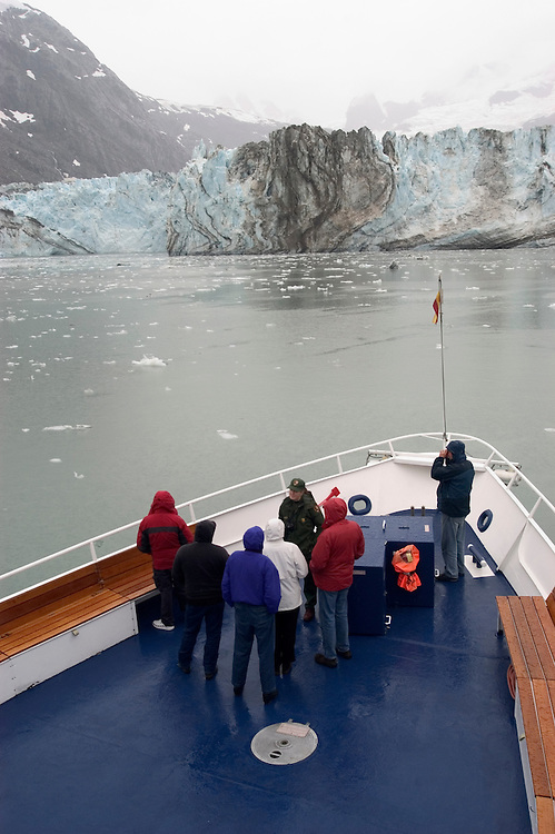 Alaska, Glacier Bay National Park..At Johns Hopkins Glacier..Cruise on Spirit of Discovery..Ranger describes Johns Hopkins to passengers..Photo copyright Lee Foster, 510/549-2202, lee@fostertravel.com, www.fostertravel.com..