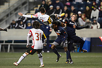 Maryland Terrapins midfielder Dan Metzger (7) goes over the top of Virginia Cavaliers forward Marcus Salandy-Defour (16) while going for a header. The Maryland Terrapins defeated Virginia Cavaliers 2-1 during the semifinals of the 2013 NCAA division 1 men's soccer College Cup at PPL Park in Chester, PA, on December 13, 2013.