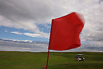 A flag whips in the 40 miles per hour winds at the Links of North Dakota golf course near Williston, North Dakota.  Located along Lake Sakakawea, the course is likened to ones in Scotland and Ireland, with links land, sand traps and wind being the chief elements to master for a good score.  The course is rated in the top 100 courses in the United States by Golf Digest magazine.  photo by David Peterson