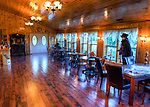The wood-lined tasting room at DeVault Family Vineyards also offers indoor tables for snacking and enjoying the wine, with a view of the vineyards outside. (HDR image)