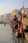 Asia, India, Varanasi. Men at Ganges river ghats of Varanasi.