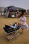Mother and twins at an RAF demonstration Bournmouth South coast England UK