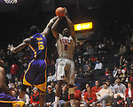 "Ole MIss forward Reginald Buckner (2)  shoots over Louisiana State's Malcolm White (5) at the C.M. ""Tad"" Smith Coliseum in Oxford, Miss. on Wednesday, February 9, 2011. Ole Miss won 66-60 and is now 4-5 in the Southeastern Conference."