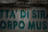 Detail of an old sign in the shade in Syracuse, Sicily, pictured on September 13, 2009, in the afternoon. The 2,700 year old Syracuse is a province and a city in southern Italy on the Island of Sicily. The island Ortigia is the historic centre of Syracuse. Today the city is a UNESCO World Heritage Site. Founded by Ancient Greek Corinthians and allied with Sparta and Corinth, it was a very powerful city-state and one of the major powers of the Mediterranean.  In the 17th century it was heavily destroyed by an earthquake. Many buildings date back to the  19th century when it regained importance. Picture by Manuel Cohen.